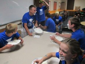 Pahranagat Valley High School seniors stuff their faces during a pie eating contest on grad night. Graduating students received prizes and one last free meal at midnight with financial support from Western Elite. (Courtesy photo)