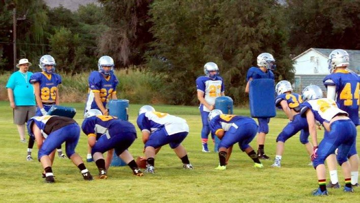 Dave Maxwell  The Pahranagat Valley football team runs through drills on the practice field this week. The record seven time defending NIAA Division IV state champions open the season at Wells Aug. 28. Their first home game is against Beaver Dam Sept. 25.