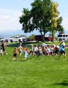 Greg Hicks Kids rush to grab water balloons at the annual water balloon fight in Pioche on Aug. 15.