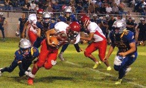 Dave Maxwell Alamo's Cody Williams and Mateo Linares tackle Beaver Dam's Manny Villareal in a 54-20 league win over the Diamondbacks. The win extends Pahranagat's national winning streak to 85 games. PVHS is on the road at Beatty this week.