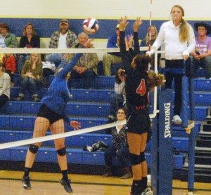 Dave Maxwell Bridon Lewis (4) of Lincoln and a teammate block a shot by a Pahranagat Valley player in their in-county match Tuesday. PVHS won 3-0. Both teams play this Saturday in their respective league tournaments with a chance to advance to the state tournament Nov. 13-14 in Las Vegas and Henderson.