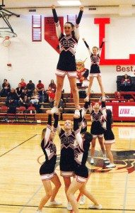 Dave Maxwell Lincoln County High School cheerleaders go through one of their acrobatic routines at a recent game.