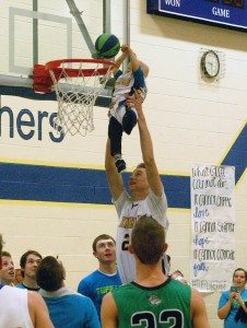 Dave Maxwell Culen Highbe lifts up Tyce Campbell to let him dunk the basketball before the PVHS-Virgin Valley game. A special benefit was held that night for the Campbell family and their 2-year old that is battling cancer.