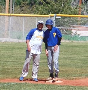 "Pahranagat third base coach Tory Frehner tells Brodey Maxwell, ""On the next pitch, I want you to steal home."" PVHS plays host to Beaver Dam this afternoon. Photo by Dave Maxwell."