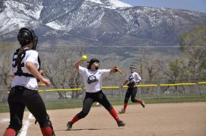 Junior third baseman Drew Cardinal throws to first for an out during games at White Pine. Courtesy photo.