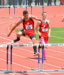 Sophomore Landen Smith (left) and junior Tyler Frehner compete in the 300 meter hurdles at the state track meet in Carson City on Friday. Smith finished second and Frehner third in the event.