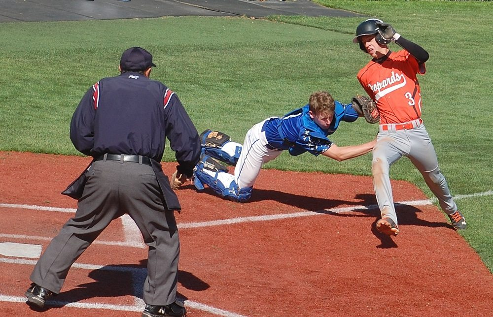 Shawn Wadsworth tags out Matthew Morgan of Wells near home plate in the state championship game. Pahranagat won 11-1 for their first title since 2013, and fifth in seven years.