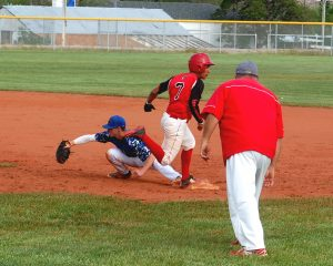 Ike Taylor makes a bang-bang play for the out at first base in Pahranagat's games with Beaver Dam. The Panthers conclude the regular season today at Indian Springs. Photo by Dave Maxwell.