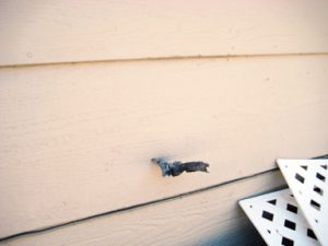 A piece of debris lodged into the side of  Clint Jenson's home, a few hundred feet away from two explosions.