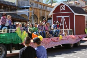 James Selman - A farm themed float rolls down the street during the parade at the Pioche Labor Day celebration.