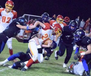Pahranagat players close in on Caleb Moretti of Whittell in the state semifinal game last Saturday, won by the Panthers 46-20. They play Spring Mountain this Saturday at Clark High in Las Vegas for the 1A State title.