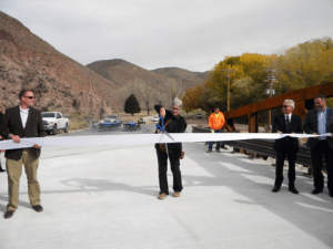 Rose Lanigan Caliente Mayor Stan Hurlburt cuts the ribbon during a ceremony on Nov. 17 celebrating the new bridge of Meadow Valley Wash.