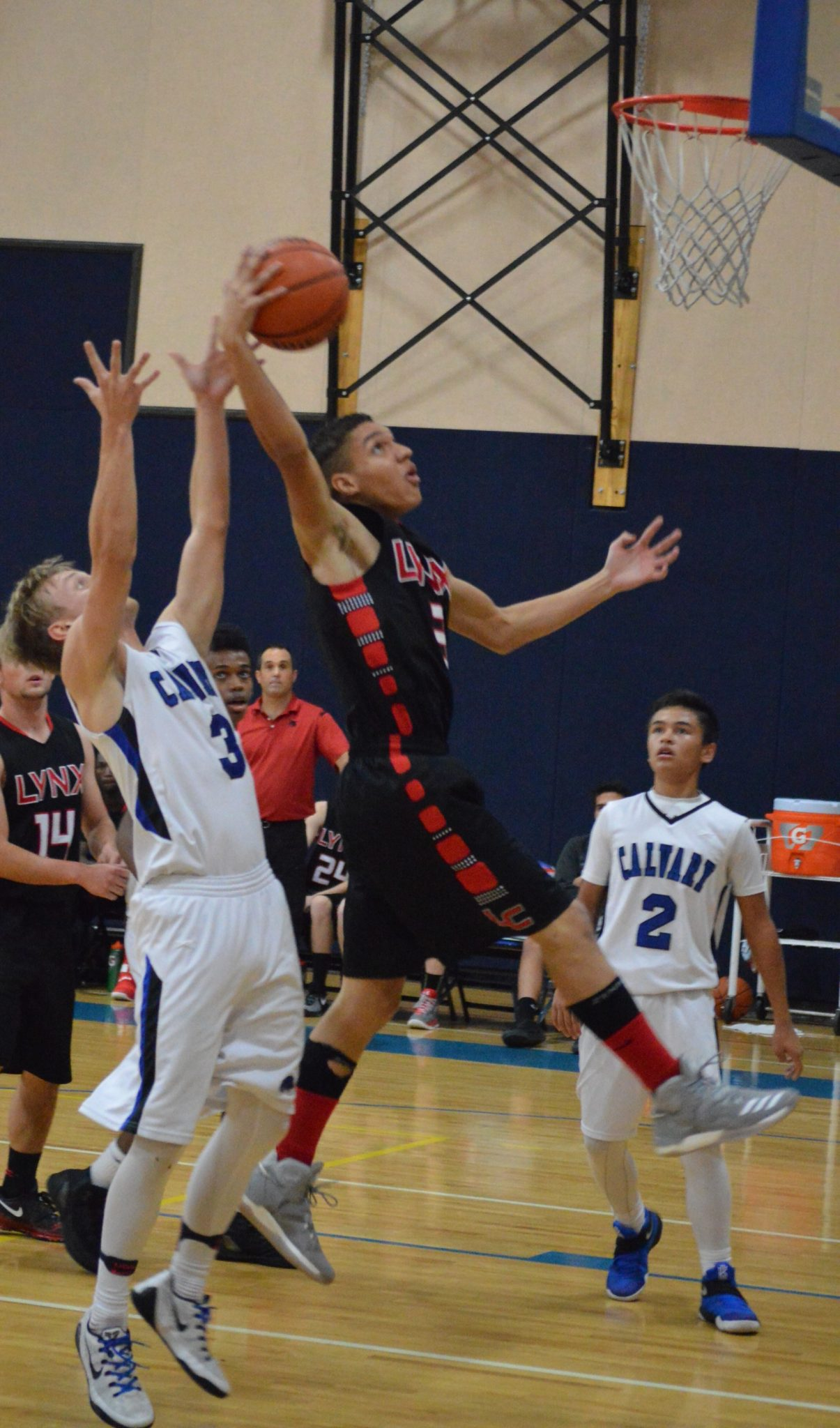 Lincoln Boys Fall to Calvary and Meadows