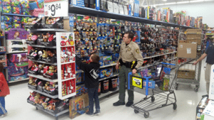 Lincoln County Sheriffu0027s Deputy Miles Umina With One Of The Kids At The Shop  With A Cop Day Last Saturday At Walmart In Cedar City, Utah.