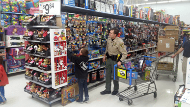 Local Children Shop with Cops