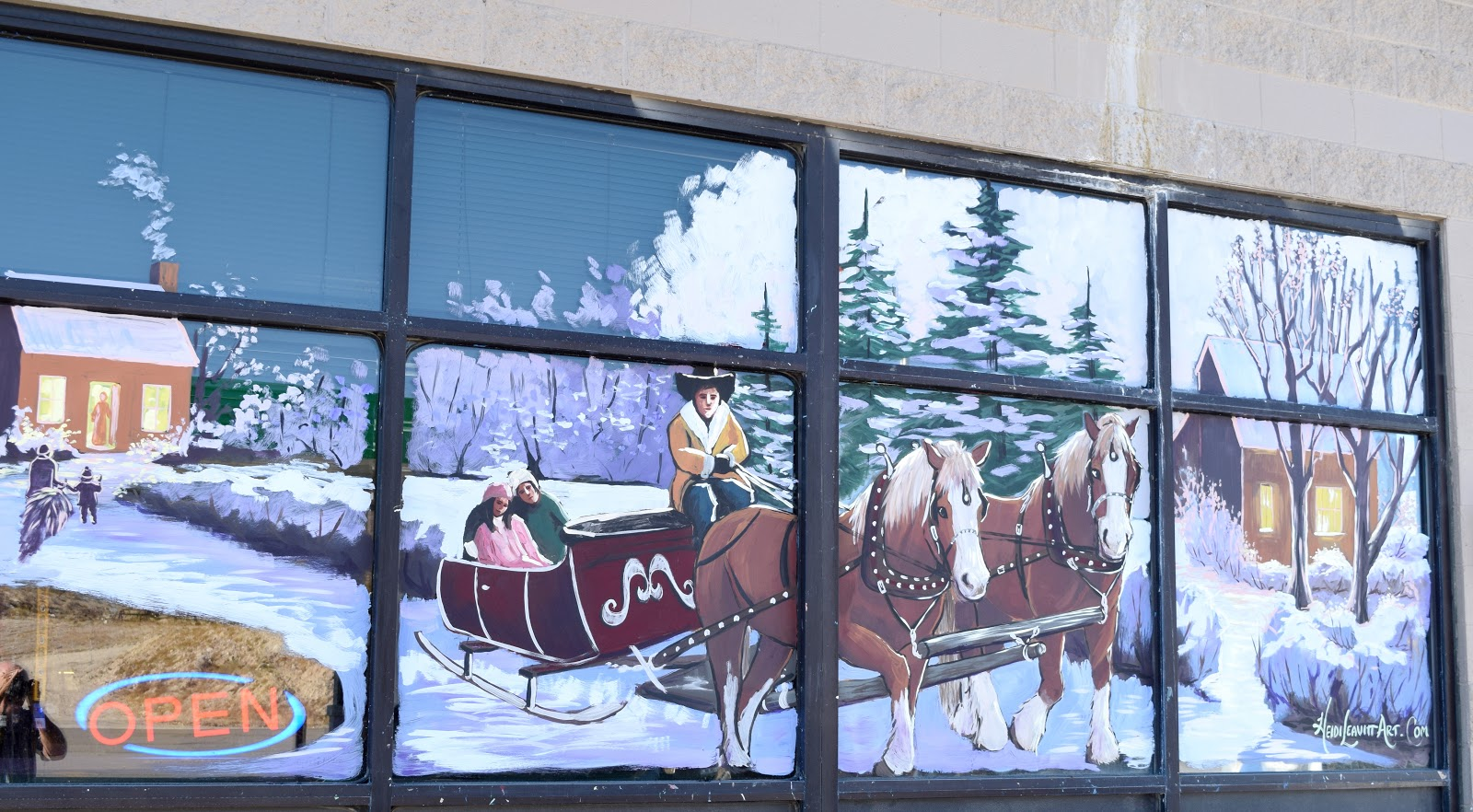 Holiday Window Paintings Brighten up Alamo Businesses